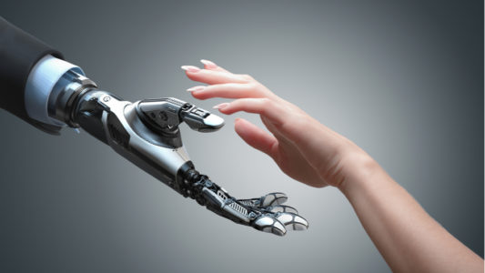 picture of Robot and human hands representing the covergence of the healthcare industry and AI