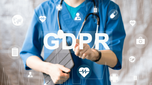 Image showing a medical professional pointing at GDPR sign
