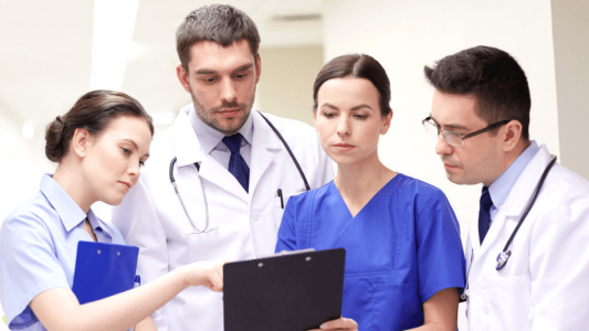 A team of haemophilia experts consult their comprehensive care plan