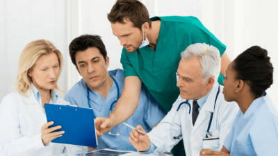 Team of doctors discuss a patient's case